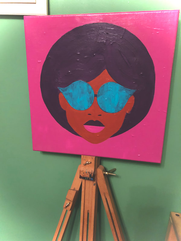 Retro lady on a pink background with sunglasses on