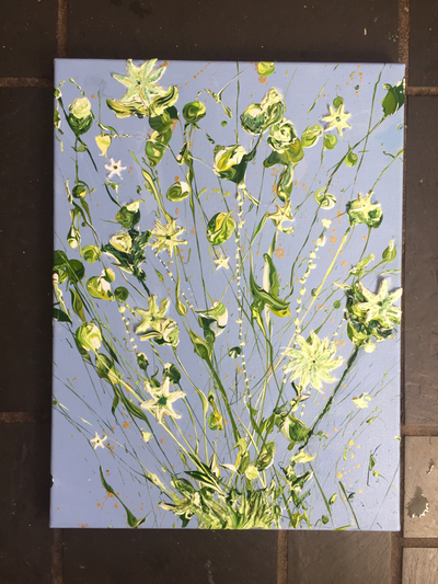 White and green lilies crawling upwards on the canvas