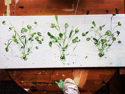 Long thing horizontal canvas with three green weed-like bunches floating equidistant across it.