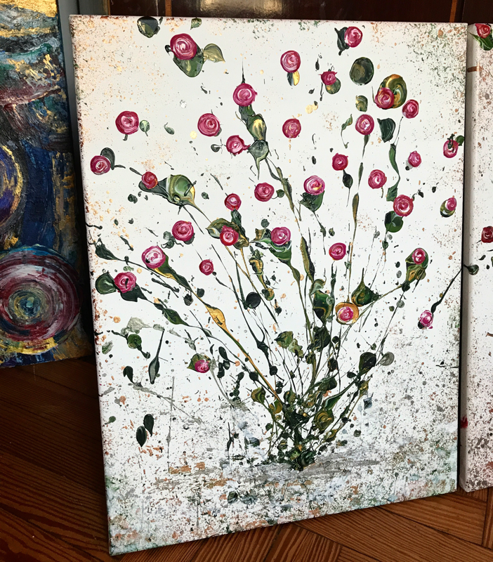 Pink bunch of roses, explosive and slightly abstract on a dappled silver background.