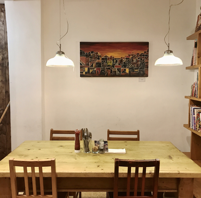 'Village' painting up in a restaurant