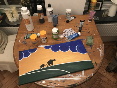 Painting of elephants on a horizon at sunset